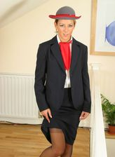 Elegant stewardess in hat and nylons takes off her fine lingerie