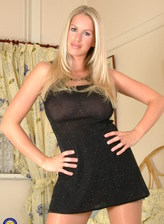 Buxom blonde UK milf Adele Stephens peels her glittery LBD and lowers tan tights