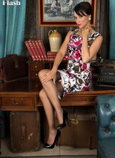 English lady Tracy Rose wears vintage stockings and lingerie under her flowery dress