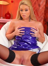 Blonde British Mistress Natalia in a purple PVC dress and lacy nylons spreads her shaved pussy