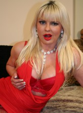 British bigtitted milf in red lingerie and fishnets stuffing a glass toy