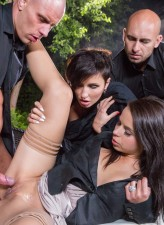 Two hotties clad in fine silk and nylon holdups open legs for a hardcore orgy outdoors