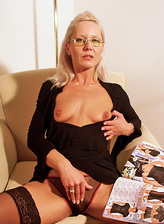 Blonde mom in glasses and stockings slides aside her thong to toy fuck her beaver
