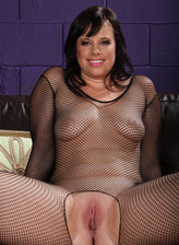 Nasty mature brunette Virgo Peridot flashes her privates in a black crotchless fishnet bodysuit