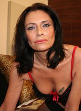 Dark-haired mature in black lacy stockings puts to use her dildo
