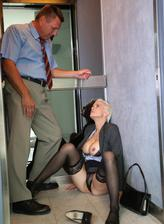 Stuck in the elevator Mila Milan opens up her Austrian butt and stockinged legs