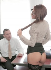 Spectacled office babe reveals lacy nylons and fuck-me-pumps getting it on at work