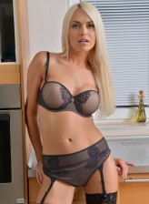 Gorgeous blonde milf Lena Love in black stockings spreads her pussy