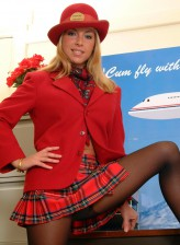 Red hot air hostess strips her sexy uniform exposing her legs in black sheer-to-waist tights