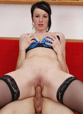 Funky milf in blue undies and black nylons jizzed after a fuck