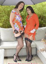 Lara Latex & Sahara Knite jump on each other in their tea gowns & seamed holdups
