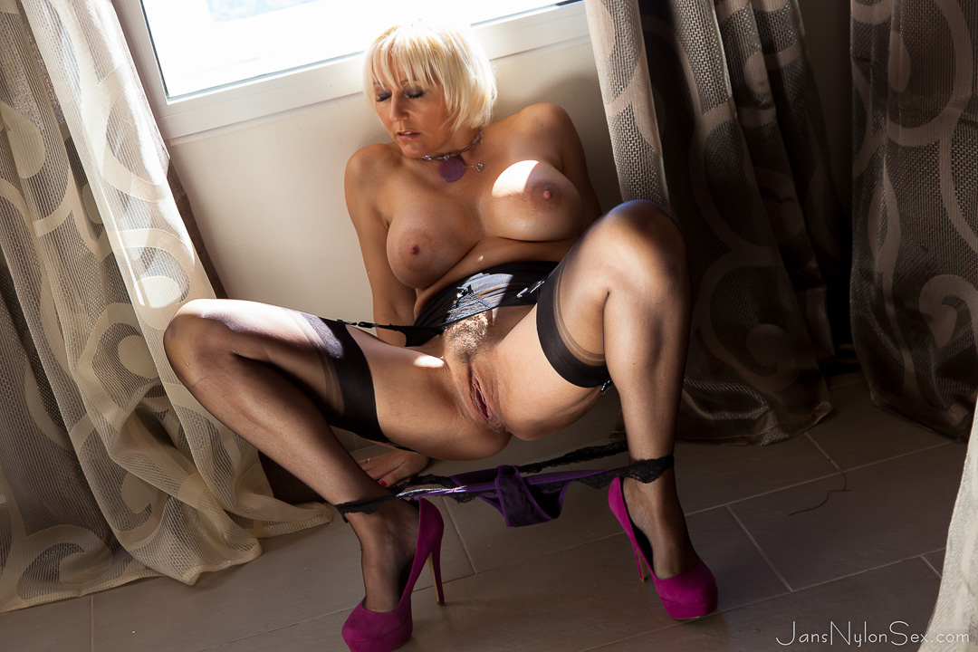 jan burton parts legs in her longline girdle and classy ff stockings