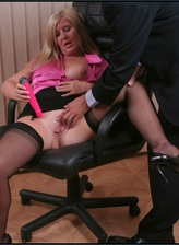 Mature secretary in black stockings warms up for her lusty boss