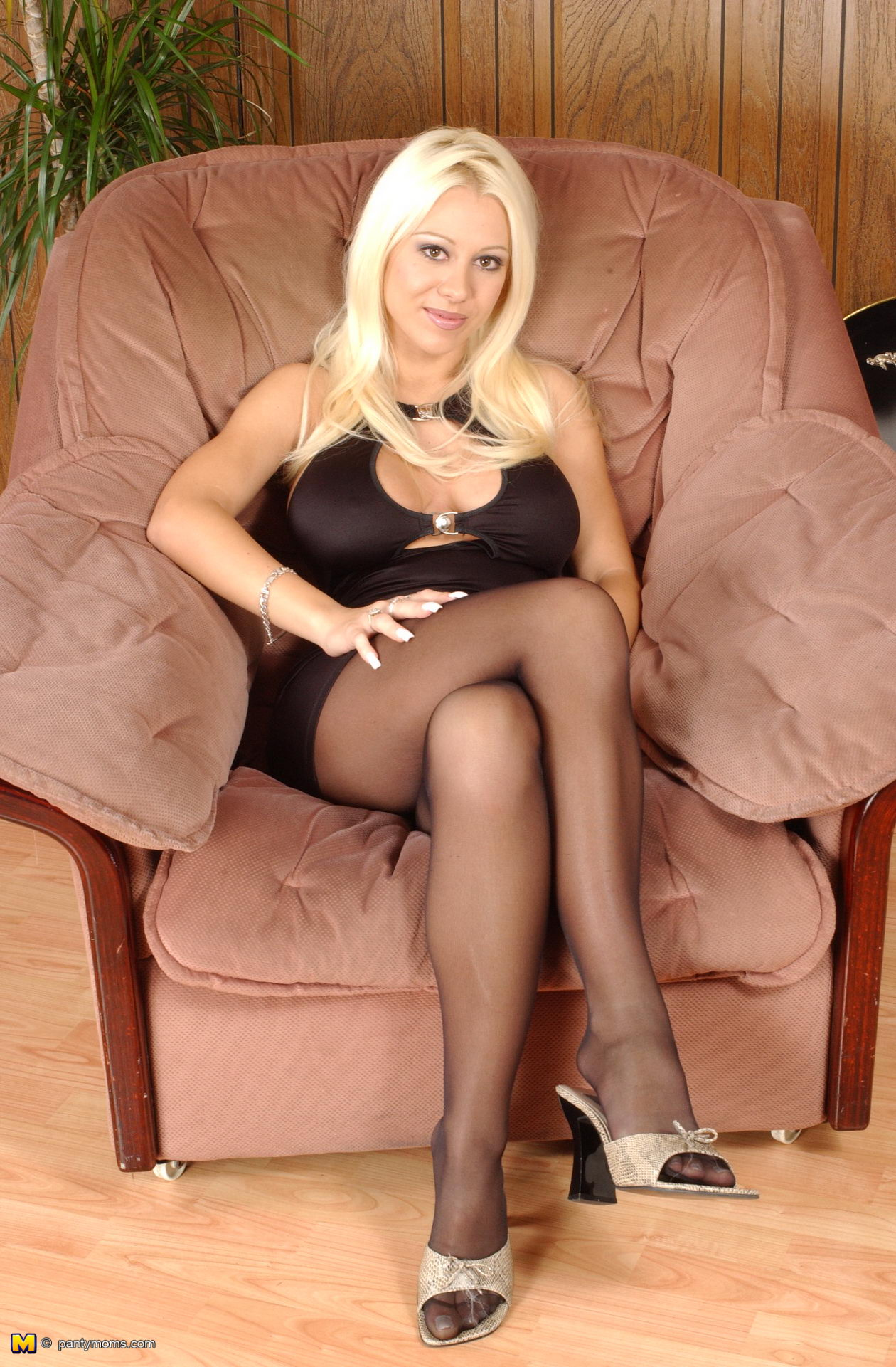 super-stacked blonde mature bombshell opens legs in sheer black