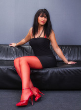 German seductress Desyra reveals her red bustier with matching red nylons and high heels