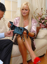 UK platinum blonde Sam Shaw dons a fine corset with attached classy FF stockings for dirty foot sex