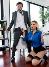 Kenzie Taylor diverts her boss's attention with her cleavage and stockinged legs