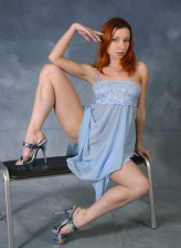 Flexy redhead Lilya in nighgown spreads long legs and rubs clit