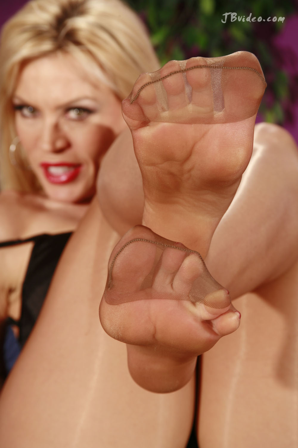 Similar. Nylon feet legs tease can suggest