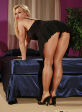 Seductive blonde hottie Amber Lynn gets to foot tease in her shiny pantyhose and seamed RHT stockings