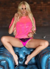 British glamour model Cara Brett all in pink showing off her pink
