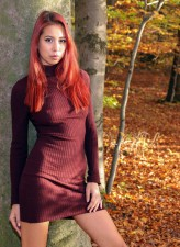 Red-haired beauty Paula Shy strips to her boots in the autumn forest to show what's between her legs