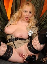 Mature Lucy Gresty toy fucks in her sheriff uniform, thigh high boots & fishnets