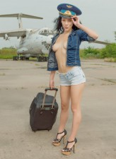 Topless lady-pilot peels off shorts and high heels to pose naked on the landing gear