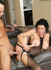 Busty strapon-armed brunette milf Veronica Avluv wears her net bodystocking to fuck and get fucked