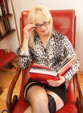 Mature blonde Tarisa wearing glasses and black fishnet stockings