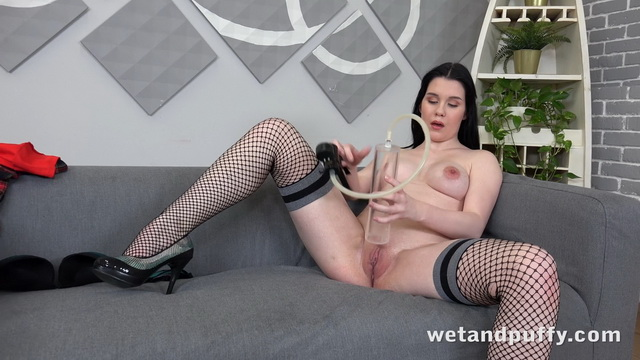 Fishnet-clad Sweet Angelina pumps her pussy before using her pink ben wa balls