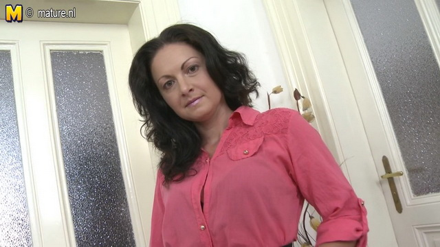 Dark-haired UK milf gets to upskirt tease and fingers her muff just in her black stockings and belt