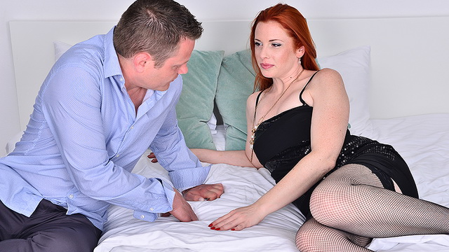 Red-haired mature Michelle Russo spreads to black fishnets for 69 and cock-ride