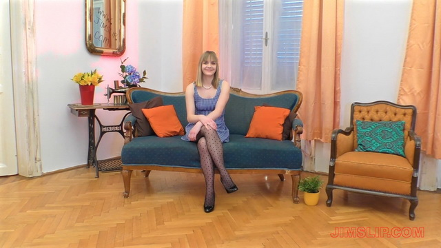 Teen student Lucette Nice lifts up legs in patterned pantyhose to touch her pink