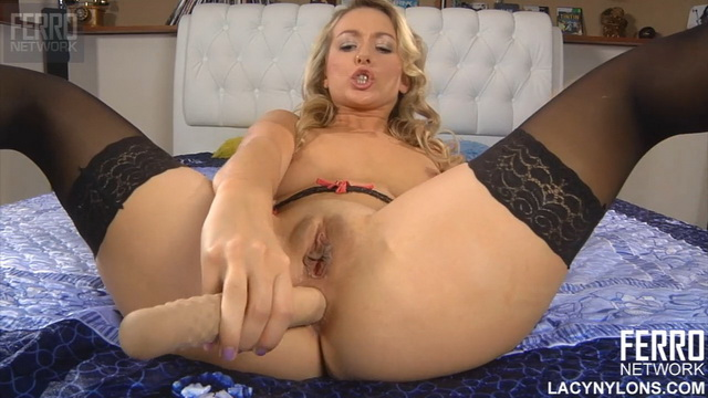 Spread-eagled blonde Denis in black lacy nylons thrusts a big dildo into her butt