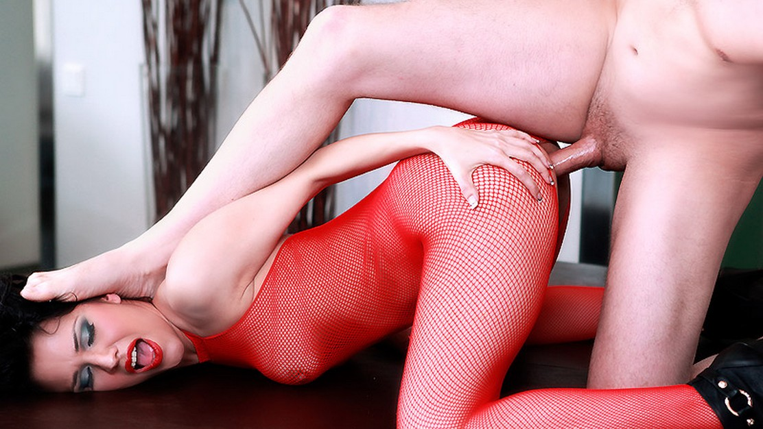 Spanish babe Samia Duarte opens legs in her red fishnet bodystocking to make up for her poker losses