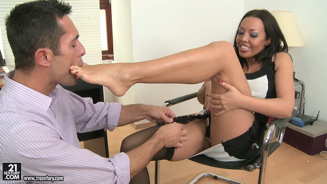 Footsie UK secretary Rio Lee gets her toes sucked in and out of her nylons for a footjob and fuck