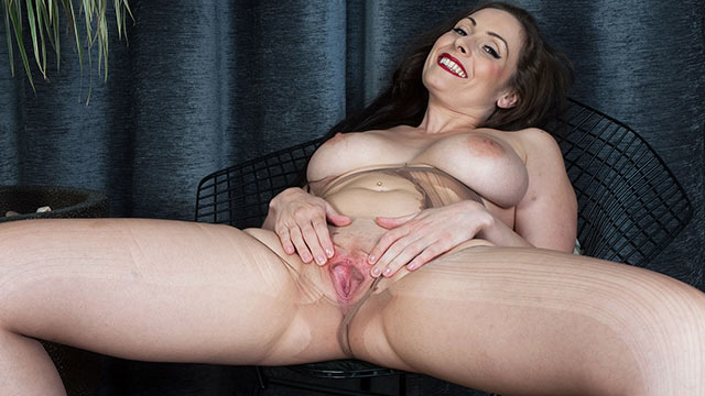 British MILF Sophia Delane strips to her sheer pantyhose and rubs her crotch