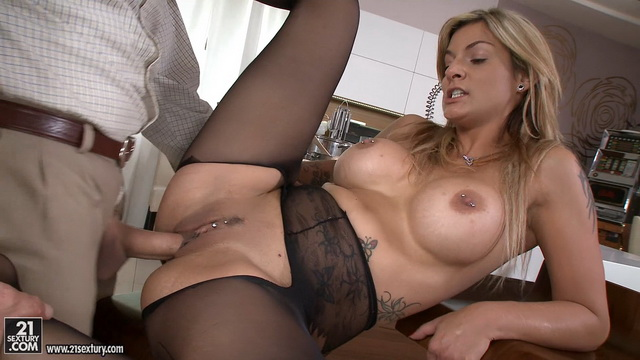 Tall blonde milf Klarisa Leone in black crotchless tights offers a tit fuck and anal for a dessert