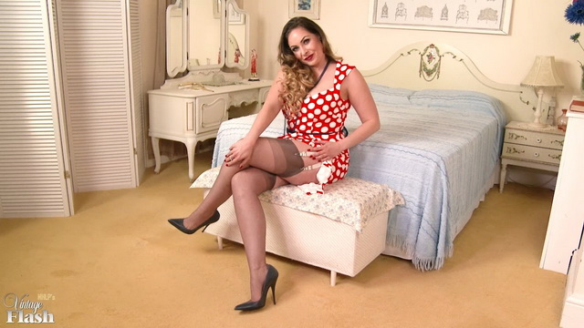 Sophia Delane frigs in a vintage polka-dot dress with fully-fashioned stockings