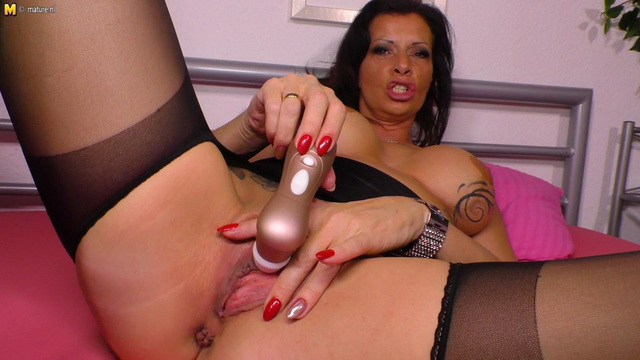 Stunning German milf Dacada spreads legs in suspender pantyhose and toys her pussy