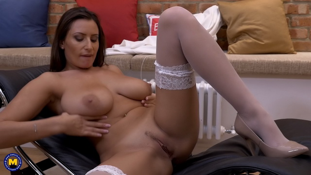 Super-busty milf Sensual Jane tempts with her cleavage and frigs in white nylons