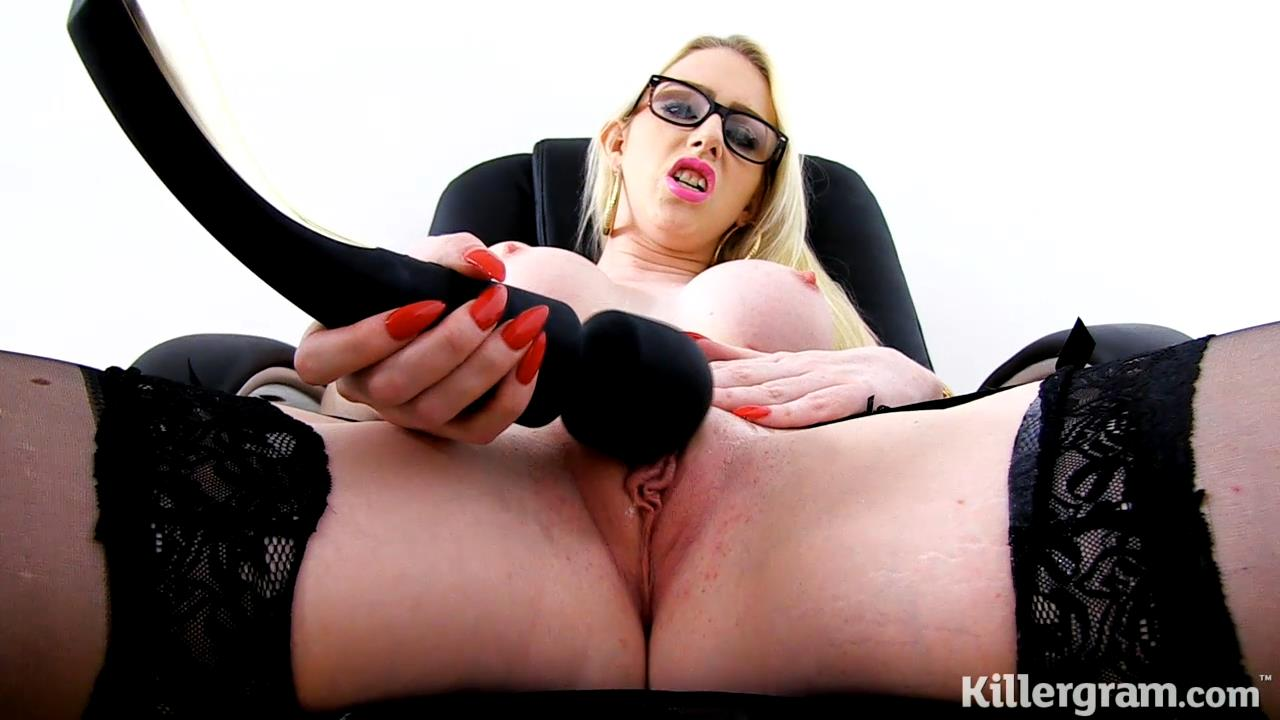 UK blonde Grace Harper gets topless and opens her stockinged legs to deal with her horny pussy