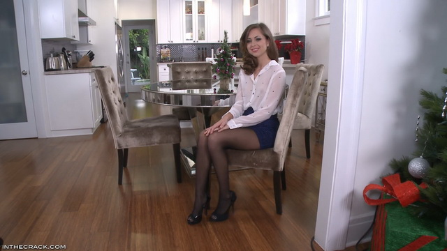 Slim-legged Riley Reid climbs a mirror table in black pantyhose to open her box