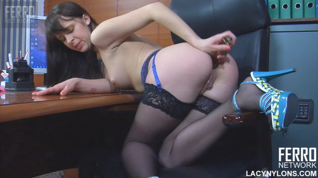 Naughty office girl Margarita A. spread-eagles in black stockings to stuff her asshole
