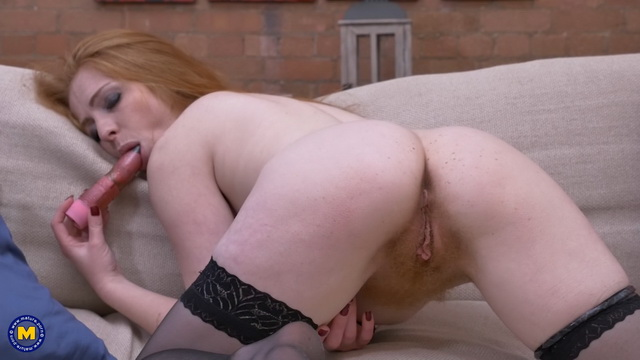 Red-haired milf Tia Jones pleasures her unshaved pussy stripping to black nylons
