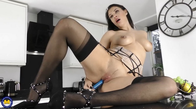 Beautiful British mom Roxy Mendez strips to her stockings and fucks herself with her toy in the kitchen