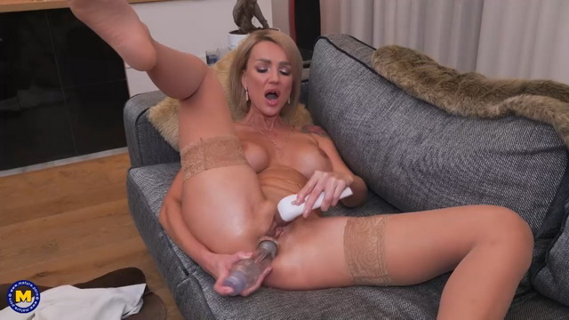 Busty blonde milf in stockings Elen Million toys her holes