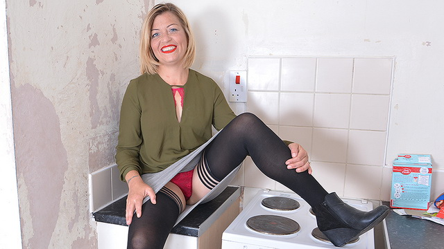 UK mature Filthy Emma dildo toys in the kitchen in her sexy lingerie and opaques