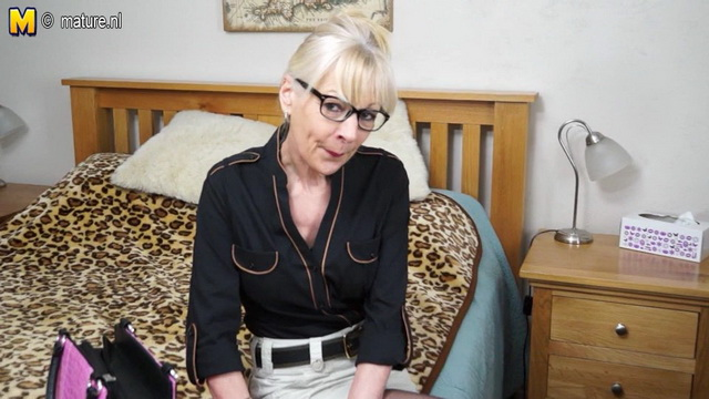 Spectacled English mature lady Elaine Mac looks hot and fit in her purple lingerie and black nylons